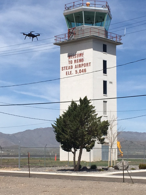 A drone flies near the Reno-Stead airport tower during an air traffic exercise April 19. Chris Walach