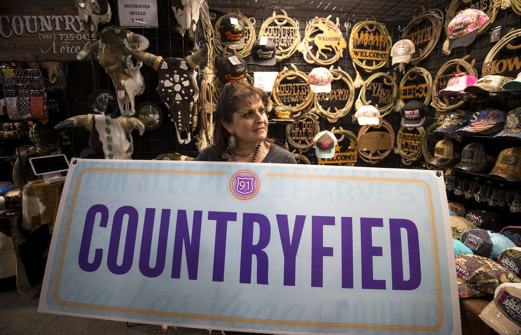 Julie Craig, owner of Countryfied Apparel, at her Stetson Country Christmas Expo booth at the Sands Expo, on Thursday, Dec. 7, 2017, with her vendor booth sign from the Route 91 Harvest festival.  ...