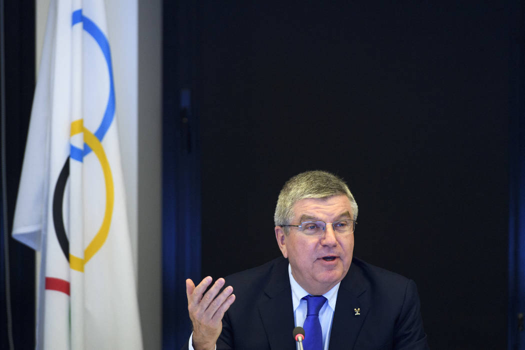 International Olympic Committee president Thomas Bach from Germany speaks prior to the opening of the first day of the executive board meeting of the IOC at the IOC headquarters, in Pully near Lau ...