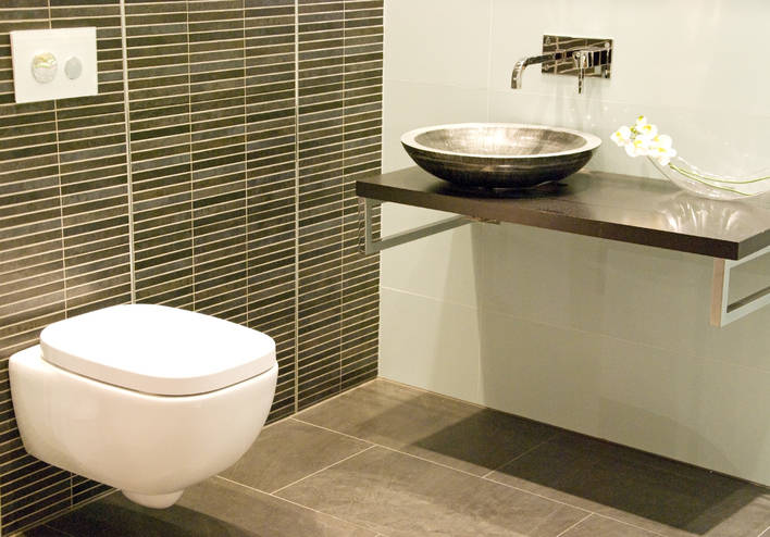 Thinkstock The wall-mounted sink and toilet open up the floor space and make the room appear bigger.