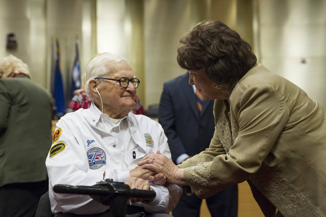 Pearl Harbor survivor Lt. Jim Downing talks with Las Vegas City Councilwoman Lois Tarkanian after he was recognized during a Las Vegas City Council meeting at Las Vegas City Hall, Wednesday, Dec.  ...