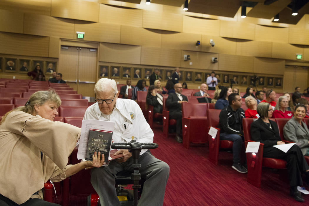 Pearl Harbor survivor, Lt. Jim Downing, second from left, with his caregiver Carol Lucke Dodge, before he was recognized during a Las Vegas City Council meeting at Las Vegas City Hall, Wednesday,  ...