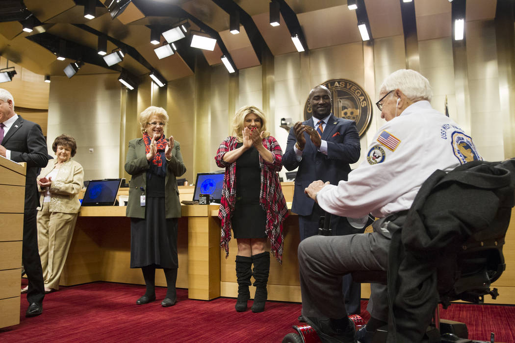 Las Vegas Mayor Carolyn Goodman, left, Councilwoman Michele Fiore and Councilman Ricki Barlow honor Pearl Harbor survivor Lt. Jim Downing during a Las Vegas City Council meeting at Las Vegas City  ...