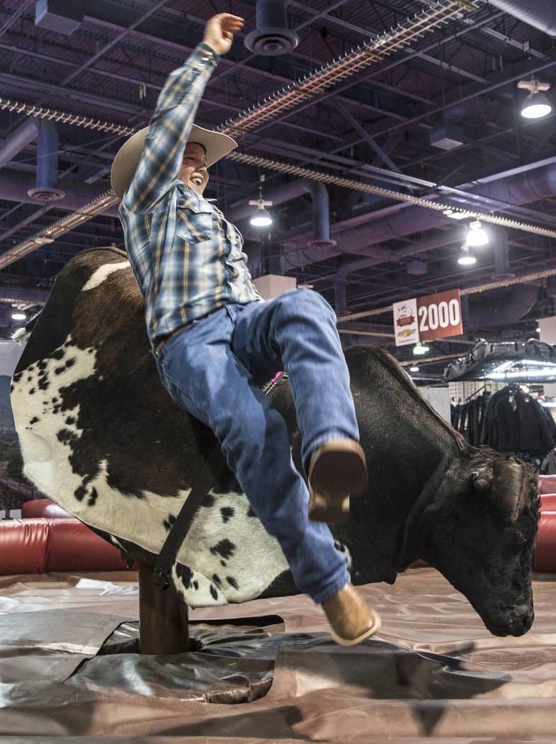 Sam Kofoed gets bucked from a mechanical bull during Cowboy Christmas on Thursday, Dec. 7, 2017, at the Las Vegas Convention Center. Benjamin Hager Las Vegas Review-Journal @benjaminhphoto