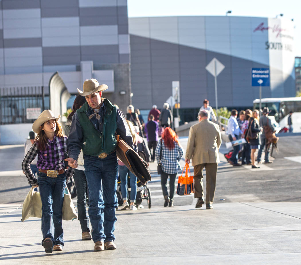 Attendees of Cowboy Christmas walk out of the Las Vegas Convention Center with bags in hand on Thursday, Dec. 7, 2017. Benjamin Hager Las Vegas Review-Journal @benjaminhphoto