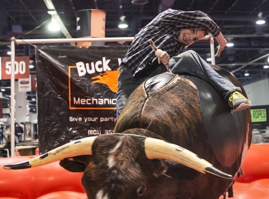 Cody Edwards rides a mechanical bull during Cowboy Christmas on Thursday c26cf7f116ec
