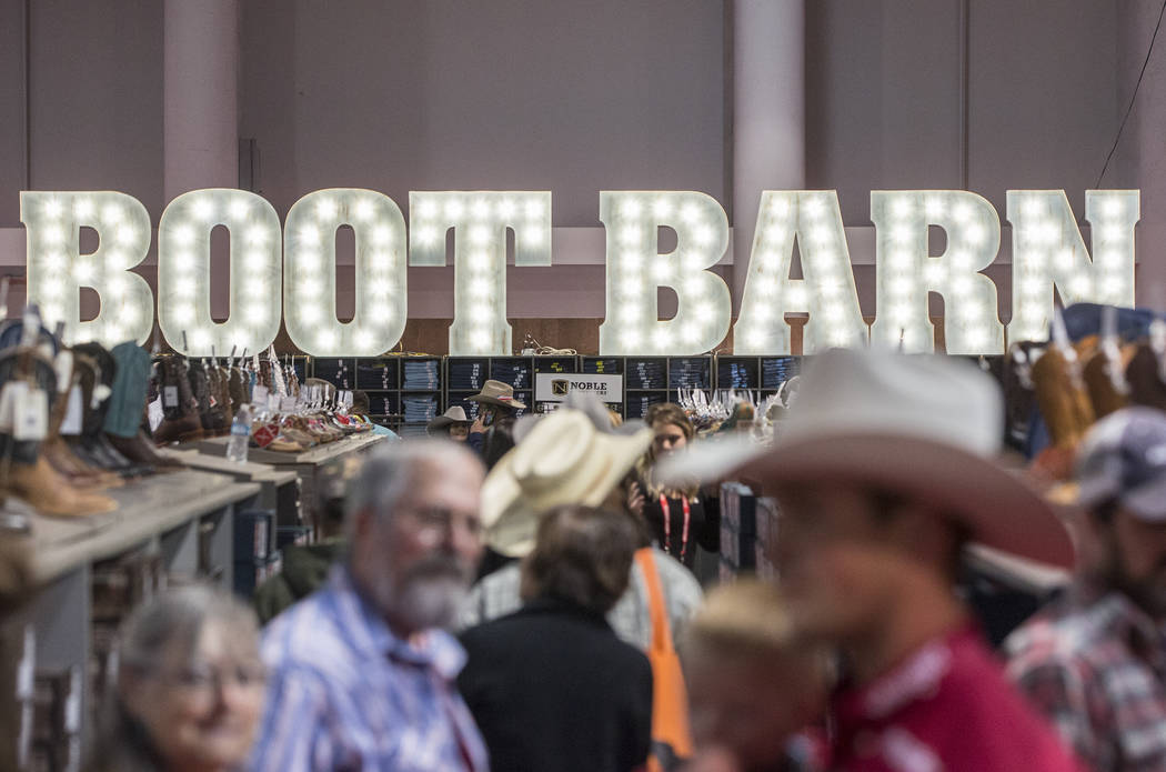 Shoppers peruse the aisles at Boot Barn during Cowboy Christmas on Thursday, Dec. 7, 2017, at the Las Vegas Convention Center. Benjamin Hager Las Vegas Review-Journal @benjaminhphoto