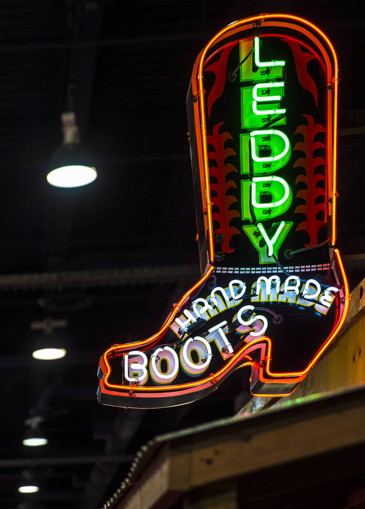 Neon signage marks Leddy Hand Made Boots during Cowboy Christmas on Thursday, Dec. 7, 2017, at the Las Vegas Convention Center. Benjamin Hager Las Vegas Review-Journal @benjaminhphoto