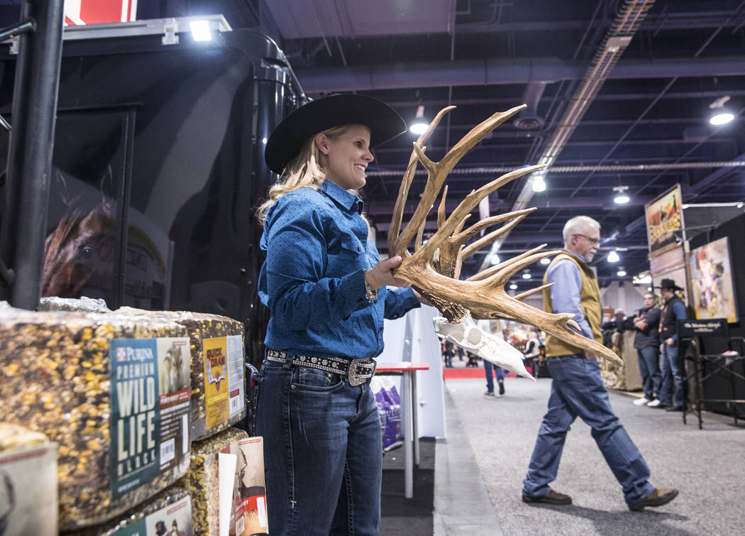 Michelle Coady holds a set of antlers at the Purina feed booth during Cowboy Christmas on Thursday, Dec. 7, 2017, at the Las Vegas Convention Center. Benjamin Hager Las Vegas Review-Journal @benja ...