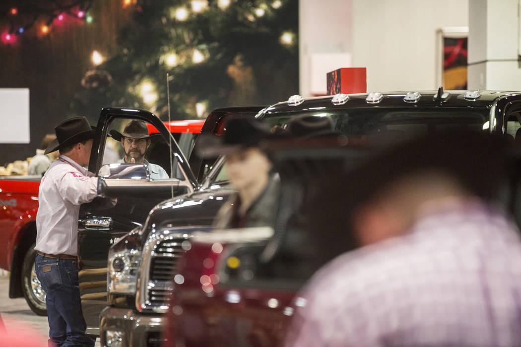 Cowboy Christmas attendees look at RAM Trucks on Thursday, Dec. 7, 2017, at the Las Vegas Convention Center. Benjamin Hager Las Vegas Review-Journal @benjaminhphoto