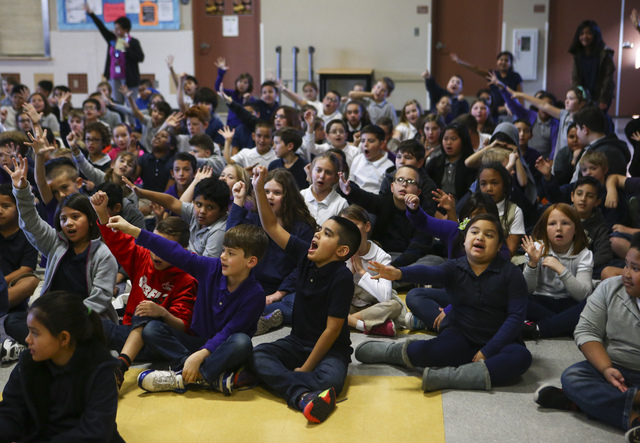Students raise their hands as Retired NASA astronaut Don Thomas talks about his experience working and living in space at Gordon McCaw Elementary School in Henderson on Wednesday, Jan. 4, 2017. Th ...
