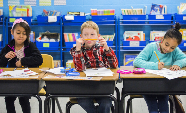 Second graders Marley Guerra, left, Alexander Miller, and Kallee Robles does class work at Bracken Elementary School,1200 N. 27th St., on Monday, Jan. 9, 2017. Bracken ES is one of 54 nationally r ...