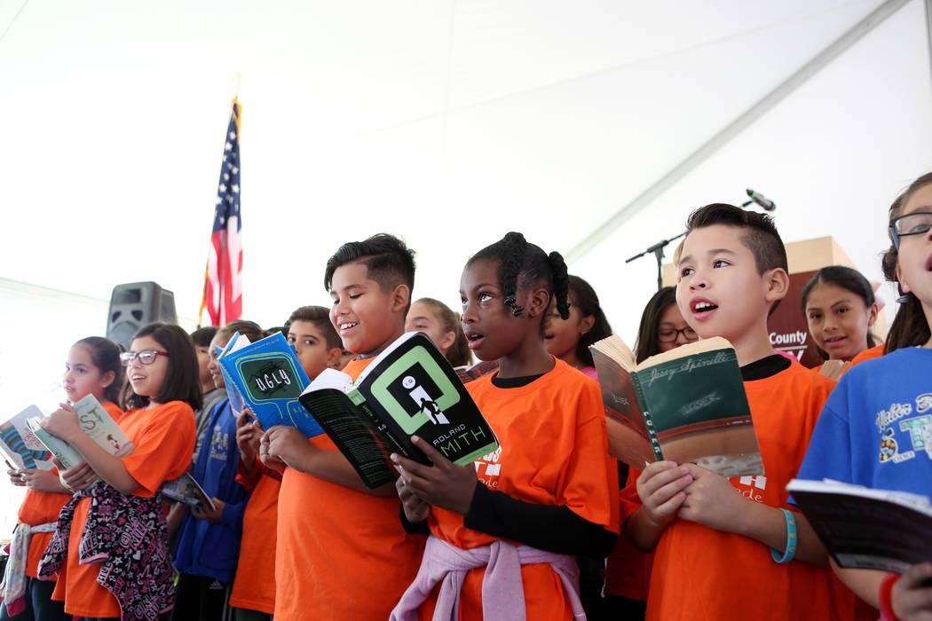 Students from Walter Bracken Elementary sing a song regarding learning from books during the Las Vegas-Clark County Library District ground breaking of the new East Las Vegas Library branch in Las ...