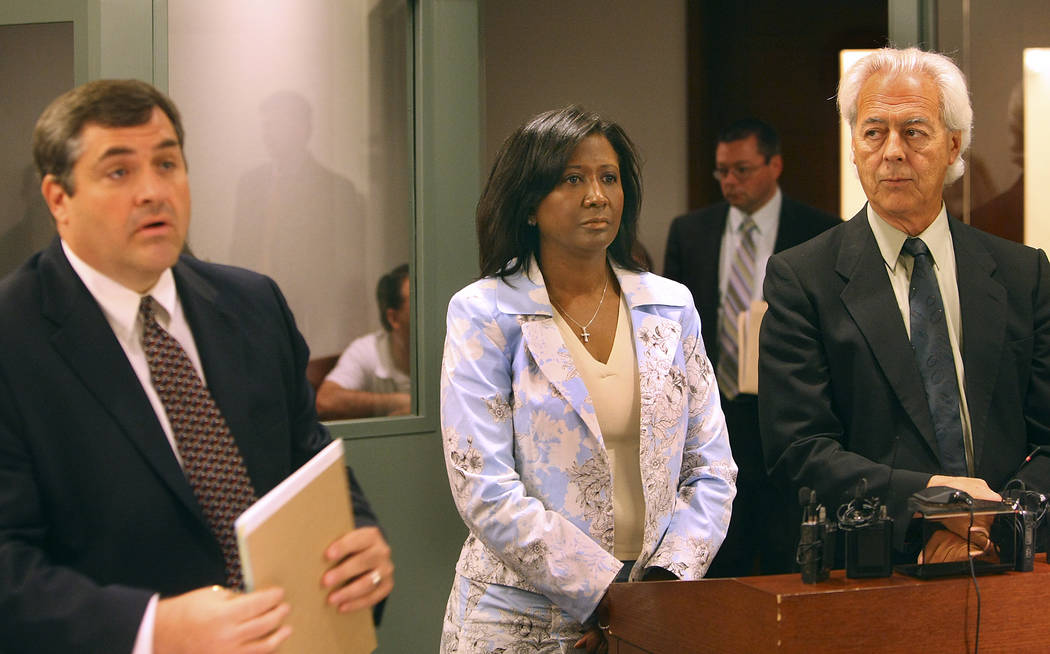 Former county commissioner Lynette Boggs (center) appears in court in 2007 with public defender Daren Richard (R) and attorney Bill Terry (L) accused of perjury and filing false documents. Boggs,  ...