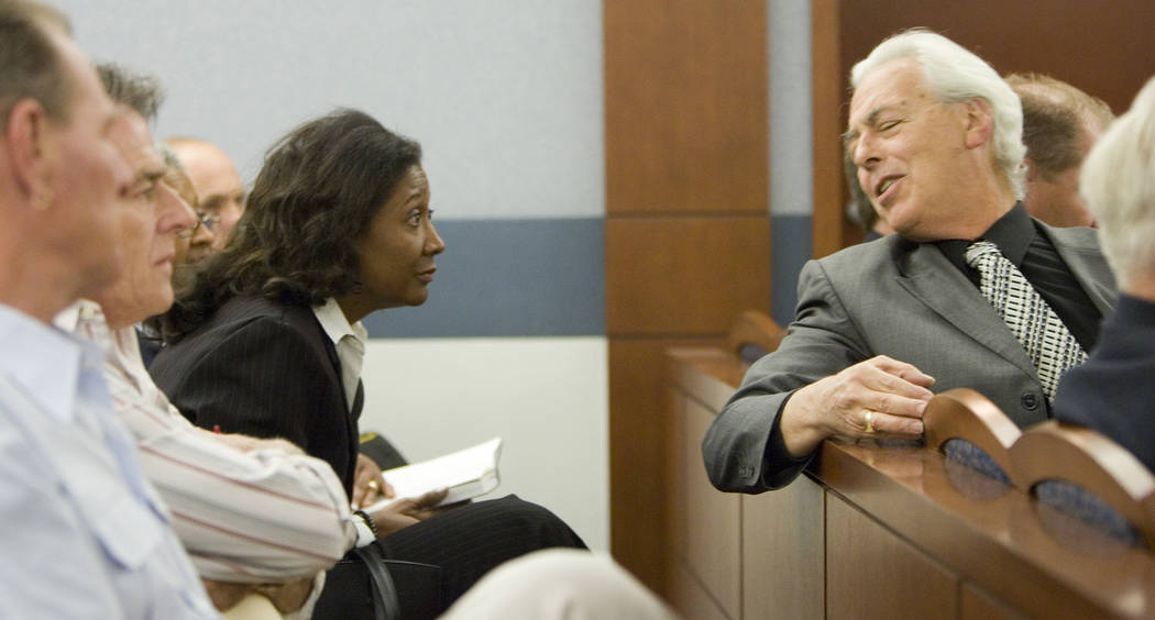 Former county commissioner Lynette Boggs leans forward to listen to her attorney Bill Terry, right, in Las Vegas Justice Court, Thursday morning, June 7, 2007. Bogss appeared in court to face felo ...
