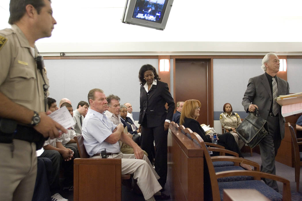 Former county commissioner Lynette Boggs, center, with attorney Bill Terry, right, appear in Las Vegas Justice Court, Thursday morning, June 7, 2007.  Boggs appeared in court to face felony charge ...