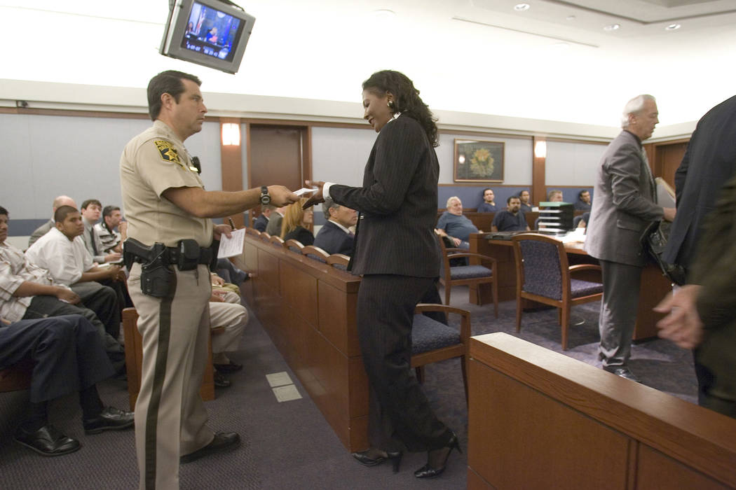 Former county commissioner Lynette Boggs is handed information by a Las Vegas Justice Court ballif, Thursday morning,  June 7, 2007, after appearing before Las Vegas Justice Court Judge Osterle to ...