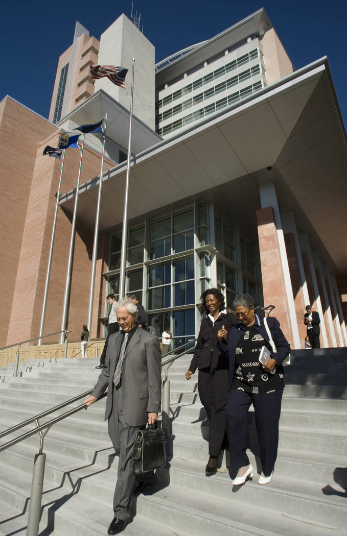Former county commissioner Lynette Boggs leaves the Regional Justice Center with her attorney, Bill Terry, left, and an unidentifed woman, after appearing in Las Vegas Justice Court, Thursday morn ...
