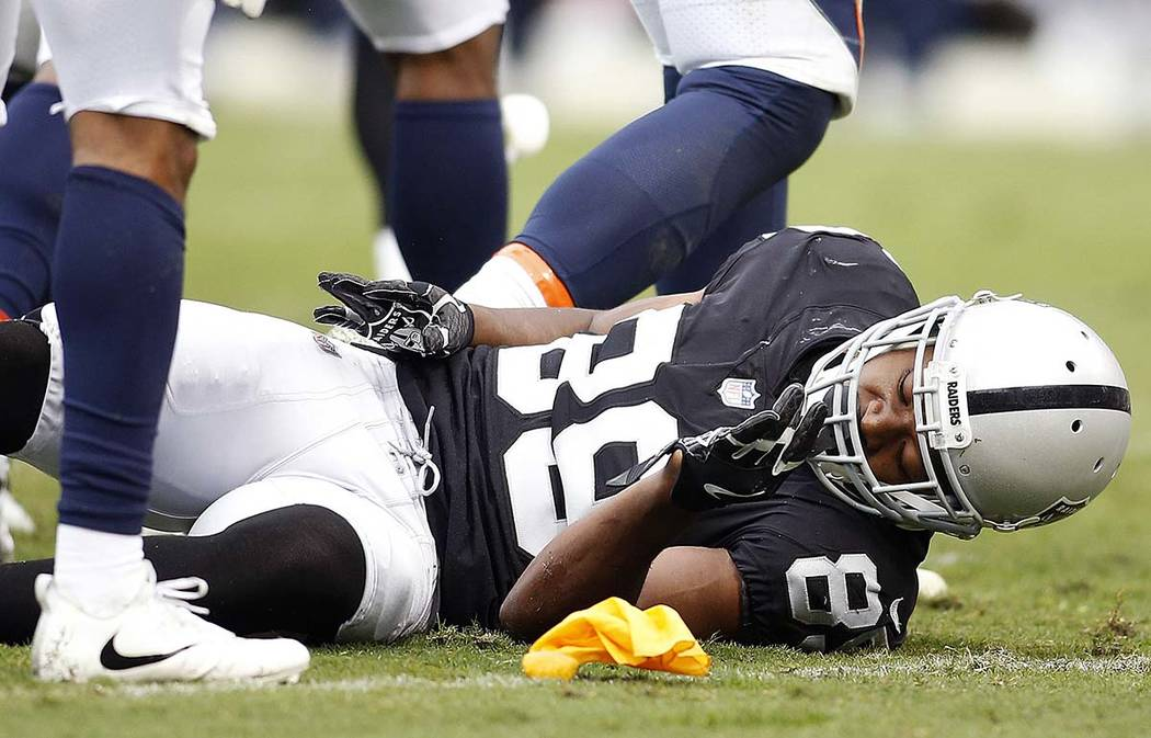 Oakland Raiders wide receiver Amari Cooper (89) remains on the ground after a hit by the Denver Broncos during the first half of an NFL football game in Oakland, Calif., Sunday, Nov. 26, 2017. (AP ...