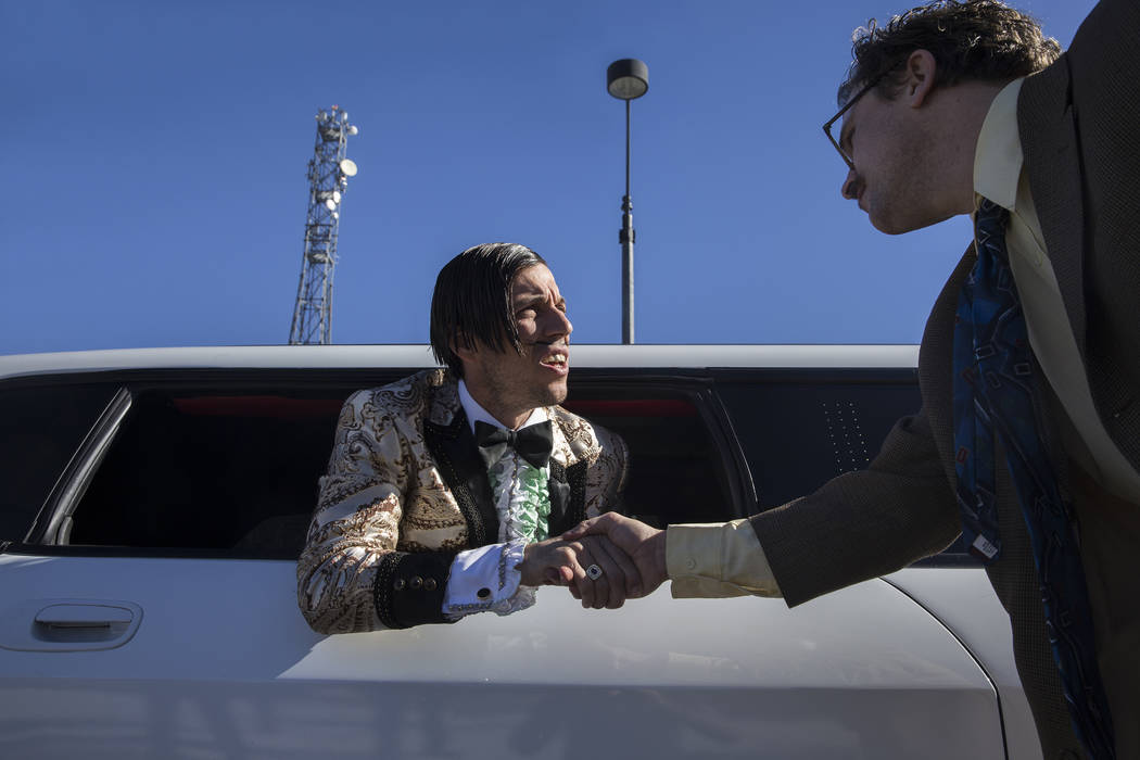 "Absinthe's ""The Gazillionaire,"" left, shakes hands with ""Harry M. Howie"" during a promotional event announcing Spiegelworld's new show OPIUM, which will open on ..."