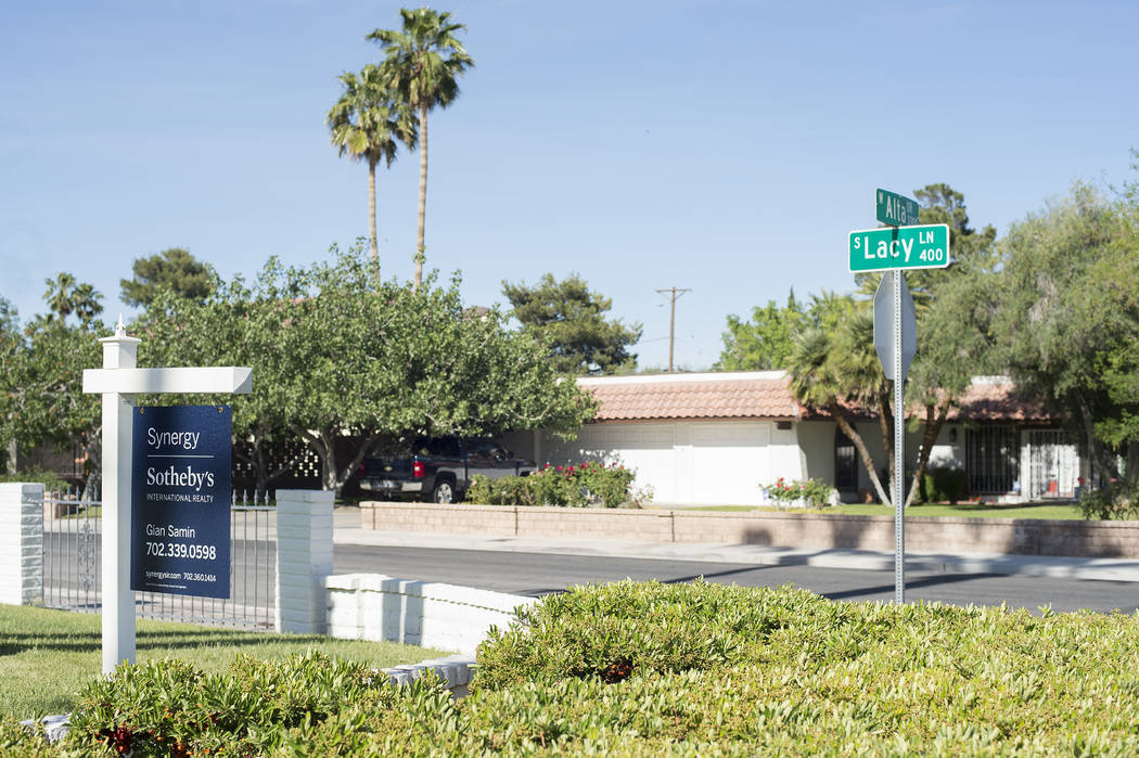 """A """"for sale"""" sign sit out front a home near the intersection of Lacy Lane and Alta Drive on Wednesday, May 3, 2017, in Las Vegas. Bridget Bennett Las Vegas Review-Journal @bridge ..."""