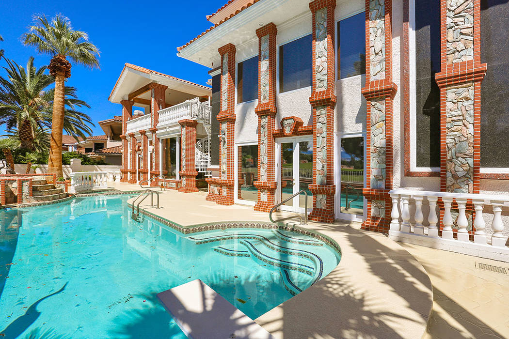 The home has a pool in the backyard. (Luxury Estates International)