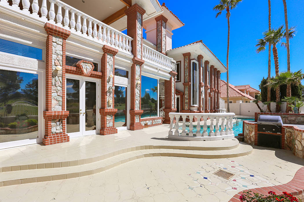 The 7,553-square-foot, three-level home has a lot of stonework. (Luxury Estates International)