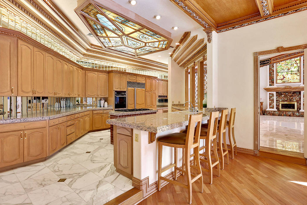 The kitchen has an adjacent bar. (Luxury Estates International)