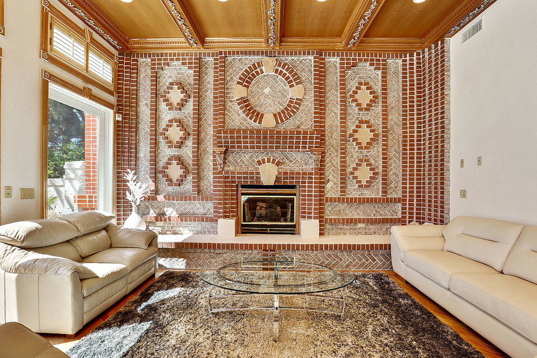 The family room has a fireplace. (Luxury Estates International)