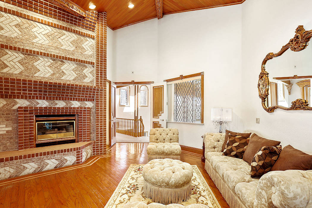 The master suite has a fireplace. (Luxury Estates International)