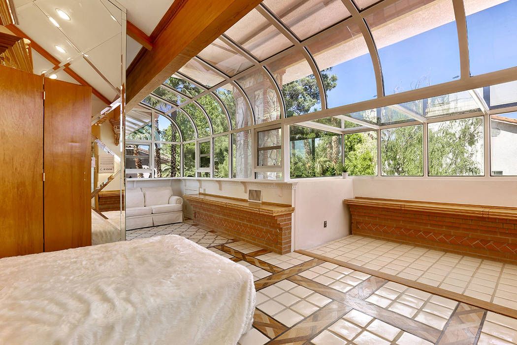 The home's large solarium next to the master retreat provides guests a Murphy bed and lots of natural light from the arched glass ceiling.  (Luxury Estates International)