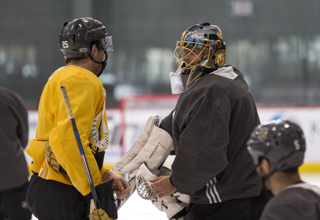 Vegas Golden Knights center Stefan Matteau (25) talks with goalie Marc-Andre Fleury during the NHL team's practice at the City National Arena in Las Vegas, Wednesday, Dec. 6, 2017. Richard Brian L ...