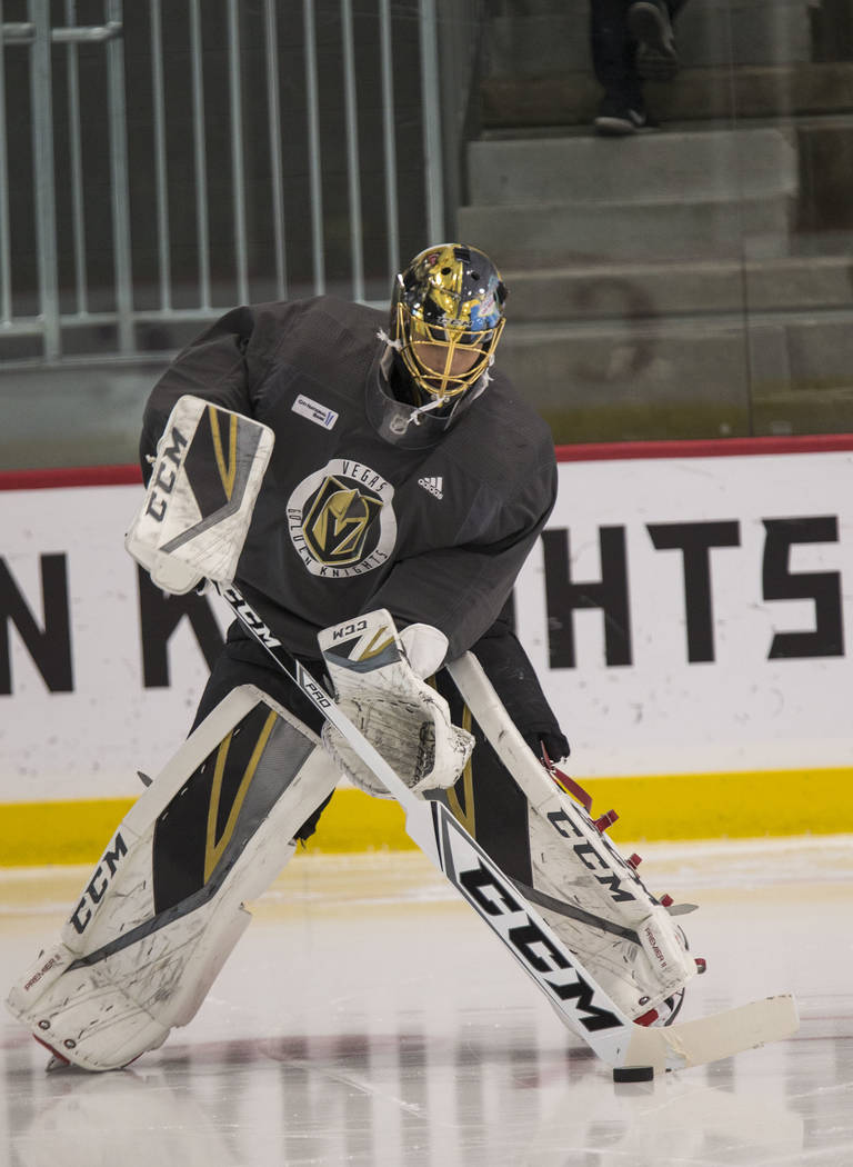 Vegas Golden Knights goalie Marc-Andre Fleury controls the puck during the NHL team's practice at the City National Arena in Las Vegas, Wednesday, Dec. 6, 2017. Richard Brian Las Vegas Review-Jour ...
