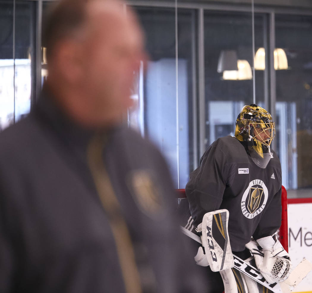 Vegas Golden Knights coach Gerard Gallant, left, and goalie Marc-Andre Fleury on the ice during the NHL team's practice at the City National Arena in Las Vegas, Wednesday, Dec. 6, 2017. Richard Br ...