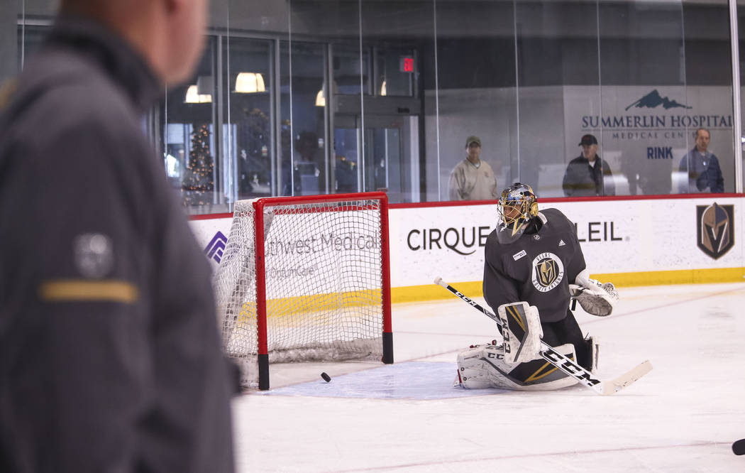 Vegas Golden Knights coach Gerard Gallant, left, watches goalie Marc-Andre Fleury during the NHL team's practice at the City National Arena in Las Vegas, Wednesday, Dec. 6, 2017. Richard Brian Las ...