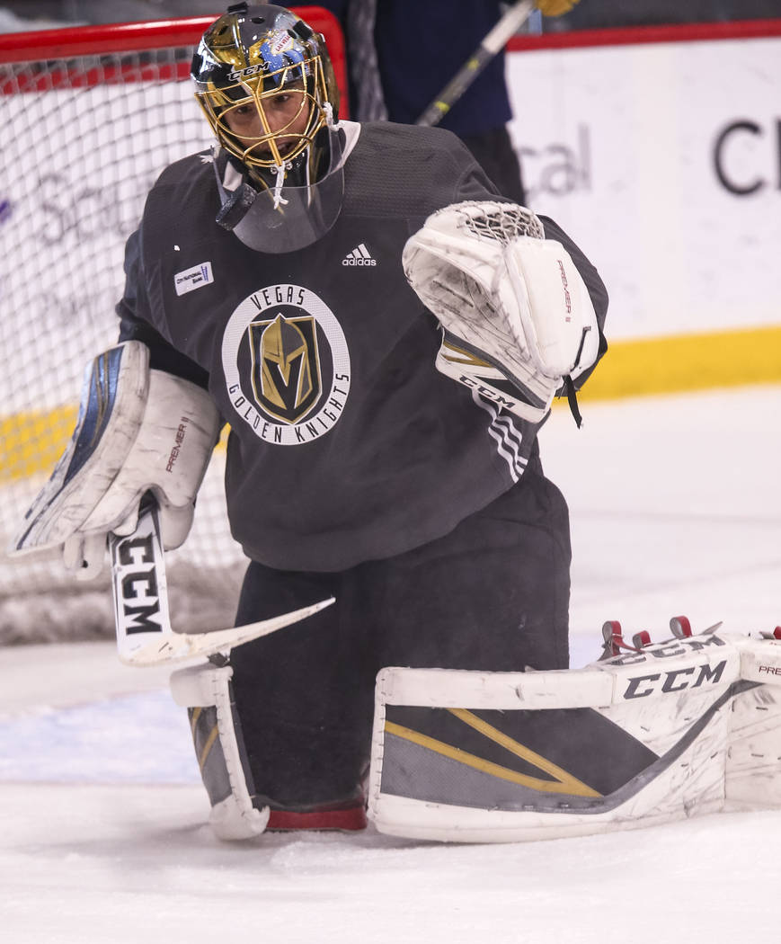 Vegas Golden Knights goalie Marc-Andre Fleury catches the puck during the NHL team's practice at the City National Arena in Las Vegas, Wednesday, Dec. 6, 2017. Richard Brian Las Vegas Review-Journ ...