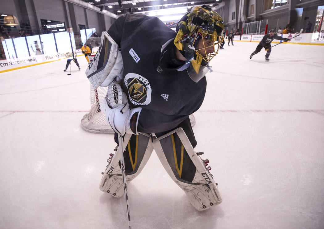 Vegas Golden Knights goalie Marc-Andre Fleury (29) controls the puck behind the net in a drill during the NHL team's practice at the City National Arena in Las Vegas, Wednesday, Dec. 6, 2017. Rich ...