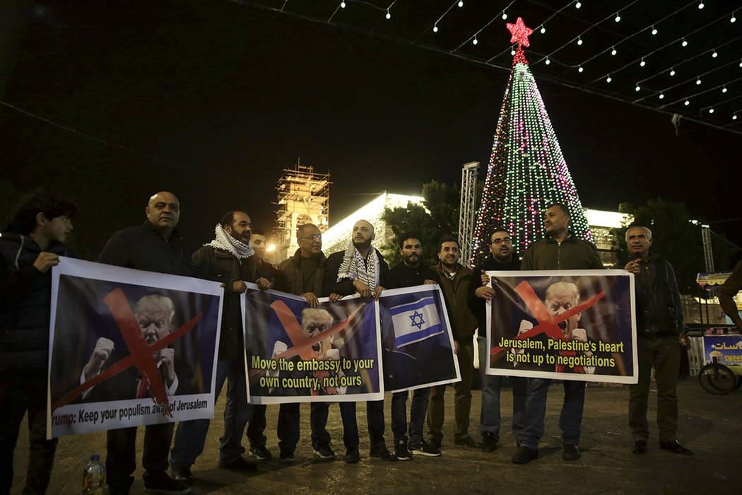 Palestinian hold posters of the President Donald Trump during a protest in Bethlehem, West Bank, Tuesday, Dec. 6, 2017.  (AP Photo/Mahmoud Illean)