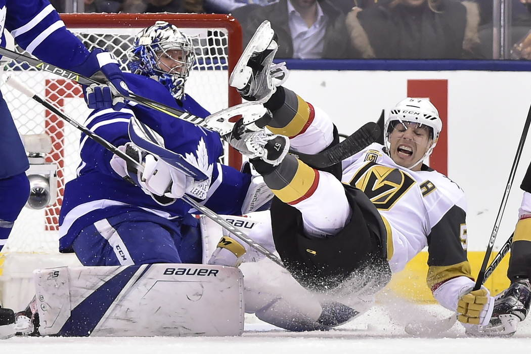 Vegas Golden Knights left wing David Perron (57) falls over Toronto Maple Leafs goalie Frederik Andersen (31) during the second period of an NHL hockey game, Monday, Nov. 6, 2017, in Toronto. (Fra ...