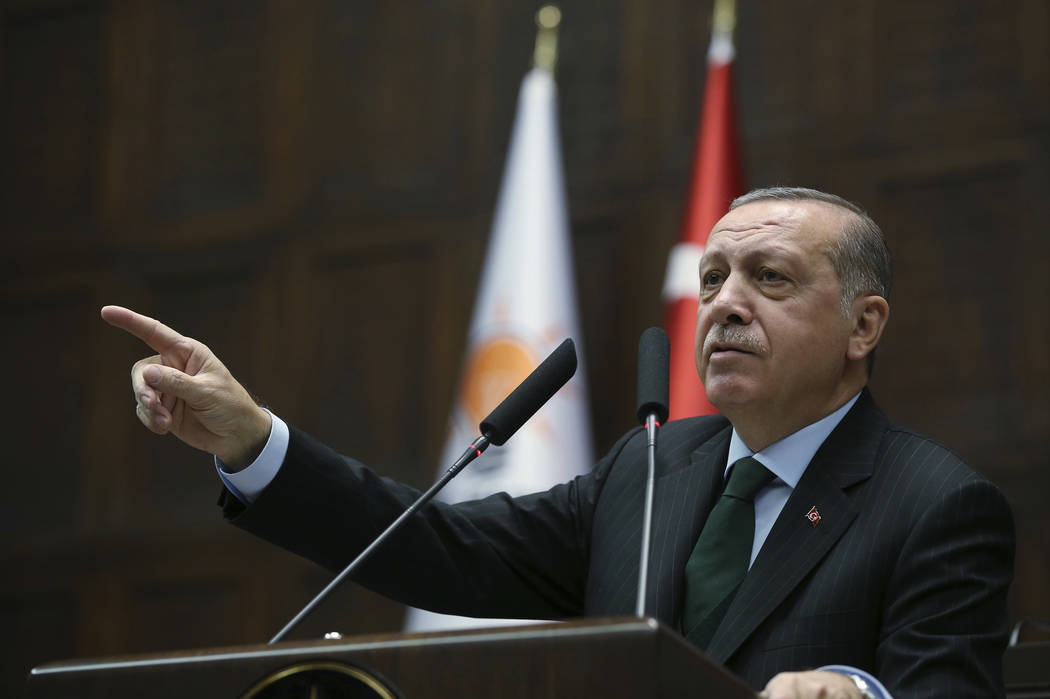 Turkey's President Recep Tayyip Erdogan gestures as he delivers a speech during a meeting of his ruling Justice and Development Party (AKP), in Ankara, Turkey, Tuesday, Dec. 5, 2017. Erdogan says  ...