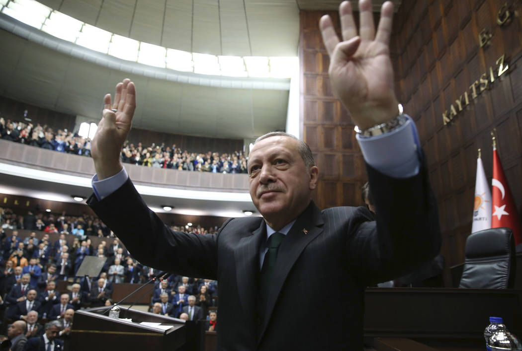 Turkey's President Recep Tayyip Erdogan waves as he arrives to deliver a speech during a meeting of his ruling Justice and Development Party (AKP), in Ankara, Turkey, Tuesday, Dec. 5, 2017. Erdoga ...
