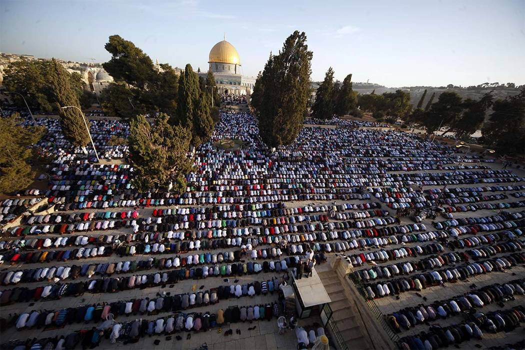 In this Sept. 24, 2015 file photo, Palestinians pray during the Muslim holiday of Eid al-Adha, near the Dome of the Rock Mosque in the Al Aqsa Mosque compound in Jerusalem's old city. (Mahmoud Ill ...