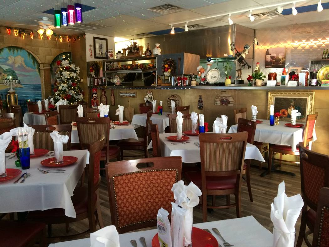The interior of Laura Rispoli's  and Michael Leonetti 's restaurant, My Mother's House, is seen Dec. 5, 2017. They purposed used old family plates, sometimes mismatching them on purpose to further ...