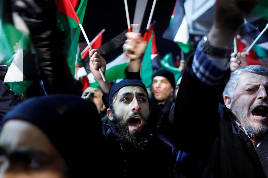 Demonstrators shout slogans during a protest against the U.S. intention to move its embassy to Jerusalem and to recognize the city of Jerusalem as the capital of Israel, near the U.S. Consulate in ...