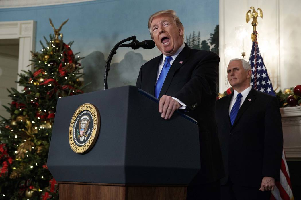 Vice President Mike Pence listens as President Donald Trump delivers a statement to officially recognize Jerusalem as the capital of Israel, in the Diplomatic Reception Room of the White House, We ...