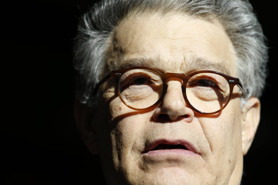 In this Nov. 27, 2017 photo, Sen. Al Franken, D-Minn., speaks to the media on Capitol Hill in Washington. Franken is denying an accusation by a former Democratic congressional aide that he tried t ...