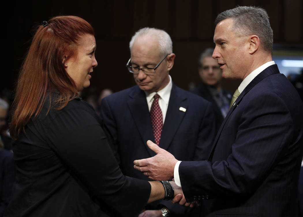 Heather Gooze, Las Vegas shooting witness, and Thomas Brandon, Acting Director of the Bureau of Alcohol, Tobacco, Firearms, and Explosives (ATF), right, talk before they testify during a Senate Ju ...