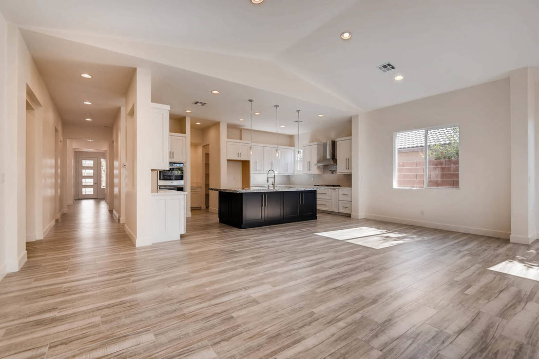 The boutique builder offers wood-look porcelain floor tile in their homes. (Paragon Life Builders)