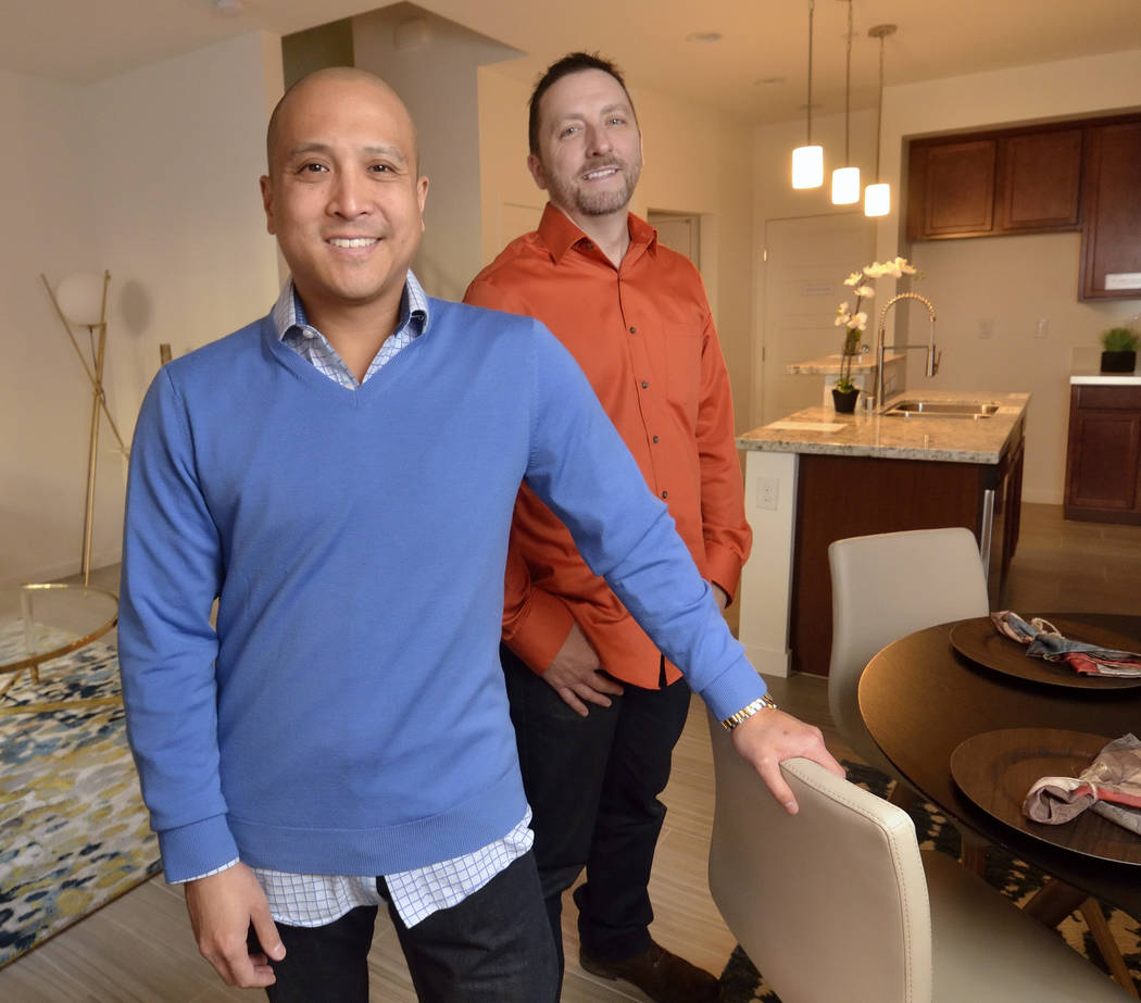 Eric Tan, left, and Mo Seebeck, co-owners of Paragon Life Builders, bought several small pads in the Loretto Bay at 1525 Spiced Wine Ave. and built eight condos, four of which are for sale. (Bill  ...