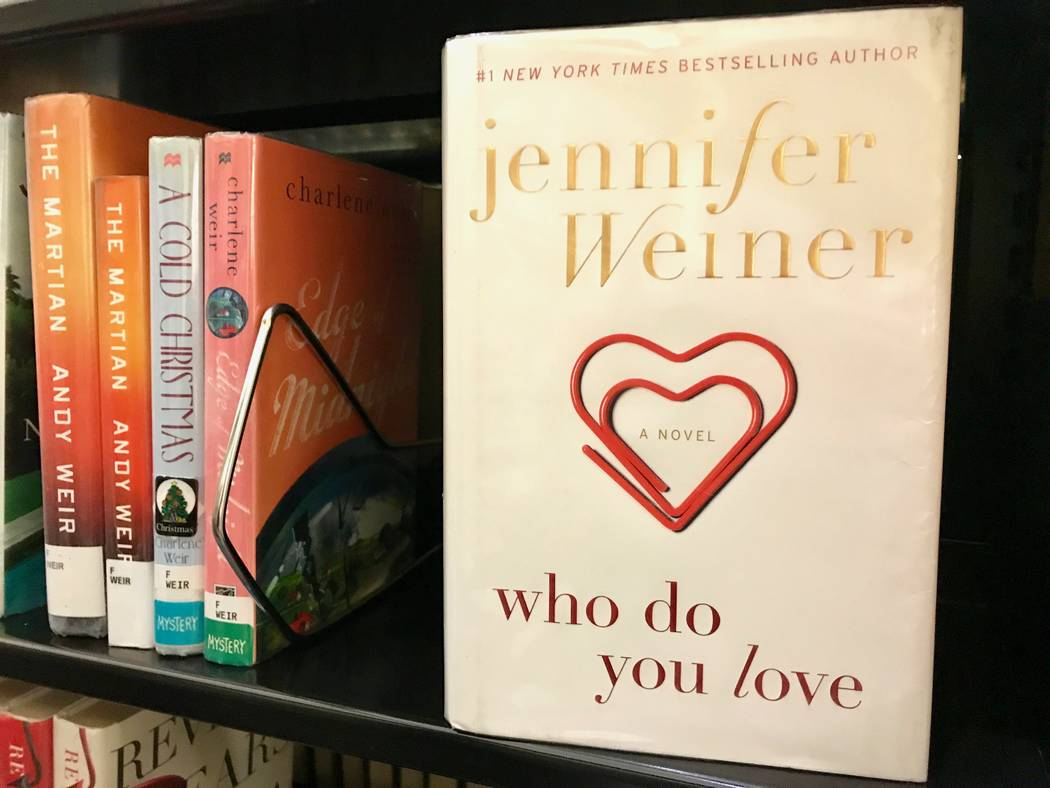 """Spring Valley branch manager Leah Ciminelli loves everything """"chick lit"""" and enjoyed reading Jennifer Weiner's """"Who Do You Love"""" this year. (Madelyn Reese/View) @MadelynGReese"""